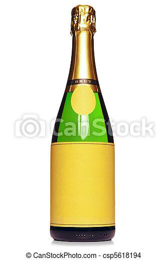 Una botella de champaña aislada en blanco - csp5618194