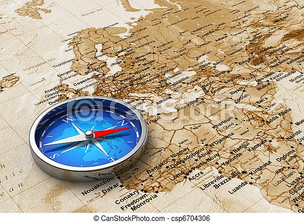 Una brújula azul en el mapa del mundo - csp6704306