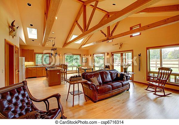 Una gran sala de estar en el rancho con la cocina. - csp6716314