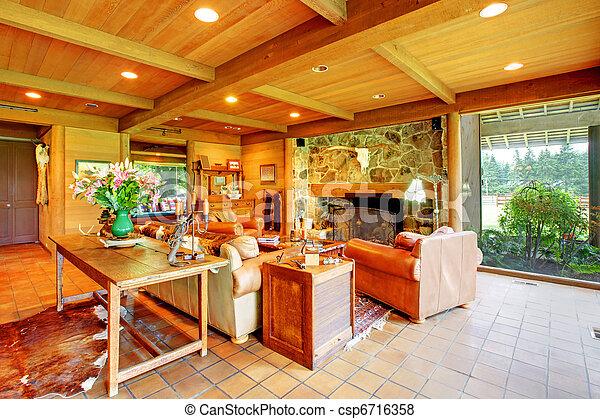 Una gran sala de estar en el rancho con la cocina. - csp6716358